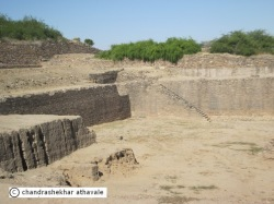 Was the eastern reservoir in Dholavira, actually a great bath, like the one in MohenjoDaro?